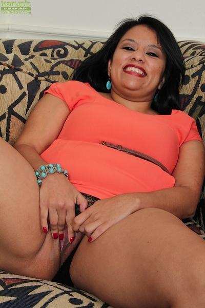 Fatty milf Lucey Perez is teasing her wet pussy and showing her big tits