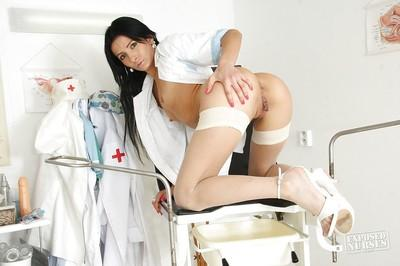 Brunette nurse in sexy uniform Victoria Rose plays with realistic toy