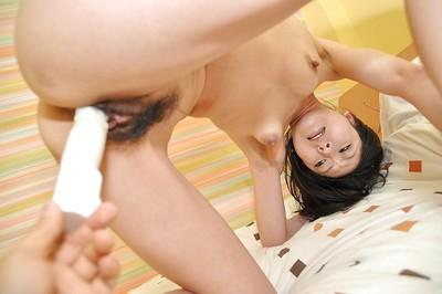 Asian milf Saeko Kojima has her hairy cunt penetrated with a toy