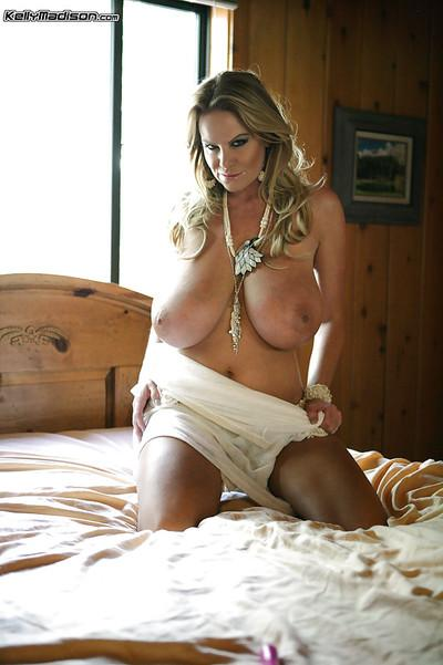 Milf amateur Kelly Madison is posing in her high heels and sexy underwear