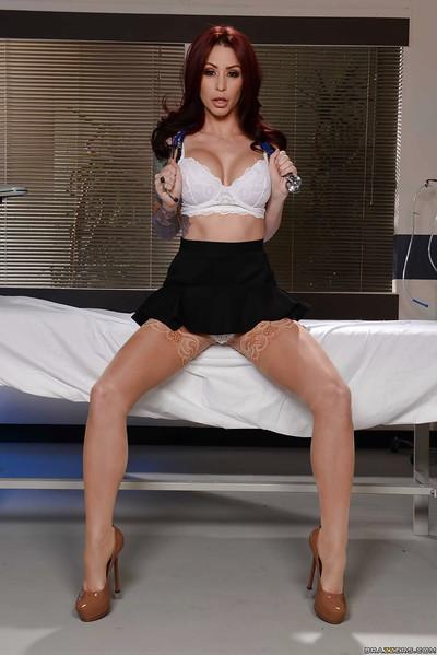 Hot doctor Monique Alexander flashing thong panties in examination room