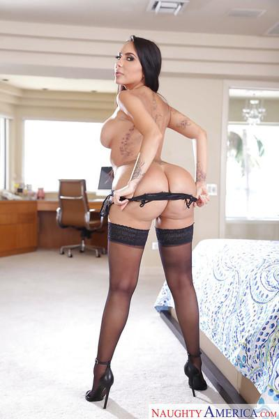 Latina housewife Lela Star poses in lingerie and flashes her big booty