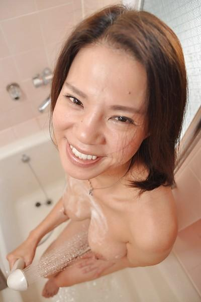 Smiley asian MILF with nice tits Yoko Kido taking shower