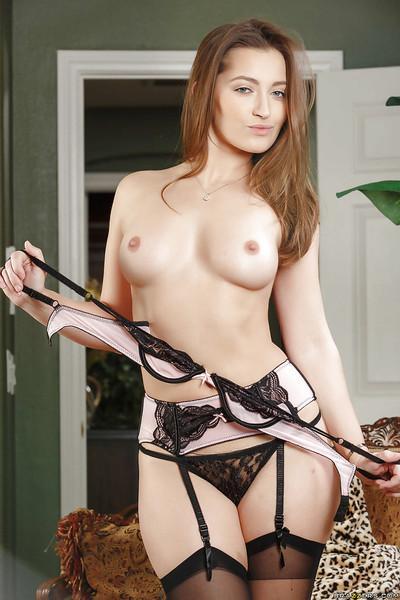 MILF Elexis Monroe posing solo in stockings, garters and high heels