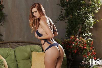 Pornstar redhead Karlie Montana shows her nice naked shape on cam