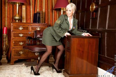 Wooing MILF in army uniform and stockings revealing her jugs and pussy