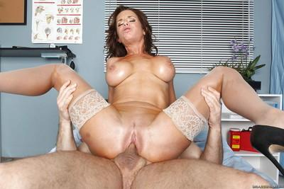 Big busted brunette MILF in white stockings enjoys hardcore pussy drilling