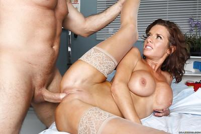 Big busted brunette MILF in white stockings enjoys hardcore pussy drilling