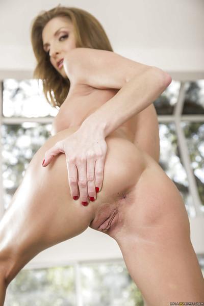 Busty MILF pornstar Silvia Saige strips off underwear to spread shaved cunt
