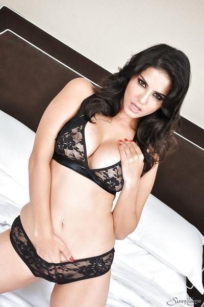 Sunny Leone demonstrates big tits and masturbates pussy on bed