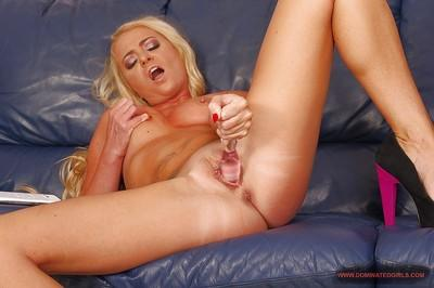Horny MILF Tiffany Doll taking off her lingerie and toying her slit