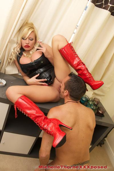 Blonde cowgirl Michelle Thorne is showing off in a latex skirt