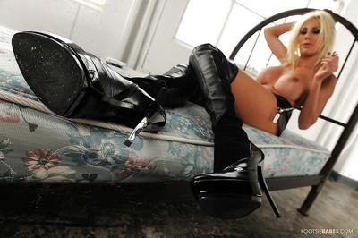 Appealing milf babe in high boots Puma Swede looks dreamy today