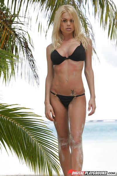 Babe blonde Jesse Jane shows off her stunning big boobies outdoors