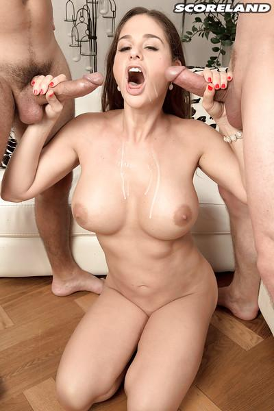 Busty MILF Cathy Heaven giving oral sex favors in MMF threesome