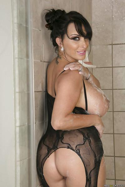 Curvy MILF in nylon suit plays with her big soapy tits in the shower