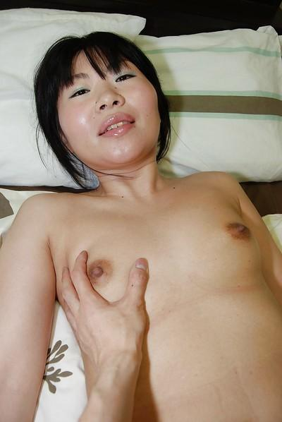 Sassy asian MILF strips down and gets her shaved gash fingered