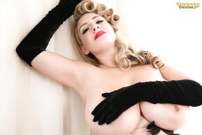 Blonde with red lips September Carrino shows her giant big tits