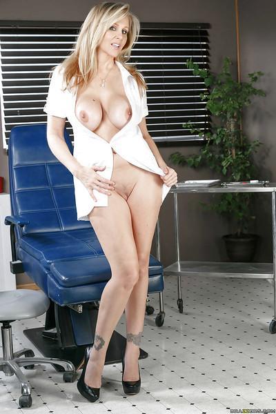 Chesty blonde MILF Julia Ann masturbating in dentist