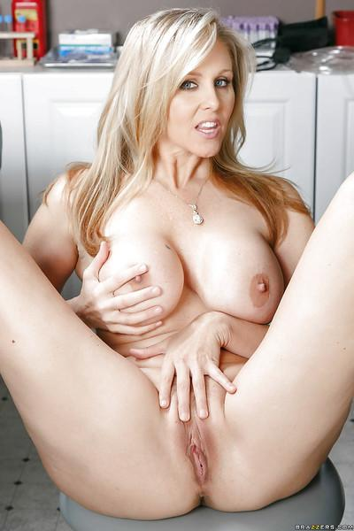 Chesty blonde MILF Julia Ann masturbating in dentist