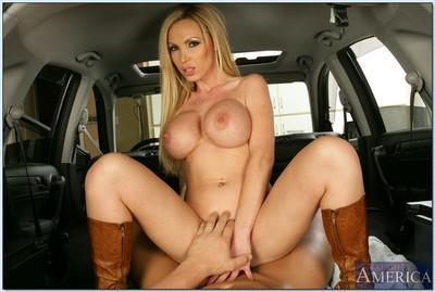 Gorgeous MILF Nikki Benz uncovers nice hooters and gets laid in a limo