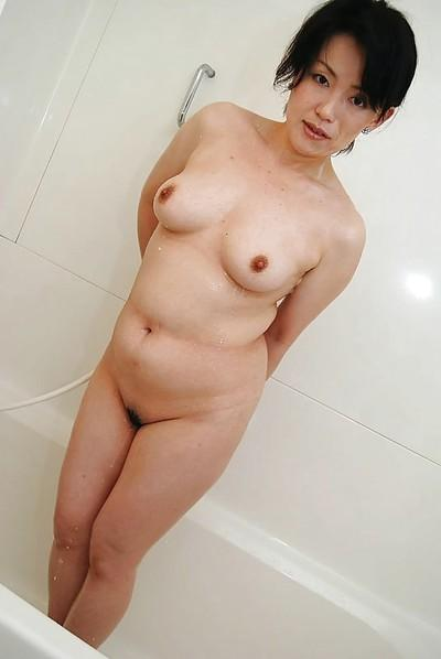 Asian MILF Misuzu Masuko taking shower and teasing her hairy cunt