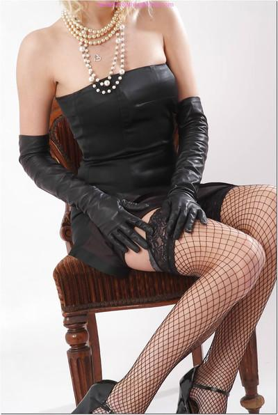 Gorgeous blonde MILF Vicky posing non nude in long black gloves and skirt