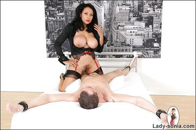 Naturally busty MILF in nylon stockings gives a great titjob