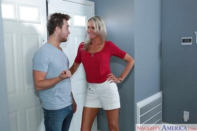 Grey haired cougar Emma Starr kisses a younger man before giving head