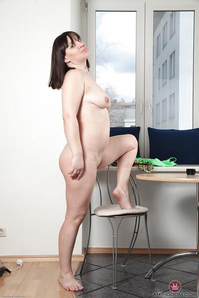 Mature lady Belta undresses for amateur masturbation session