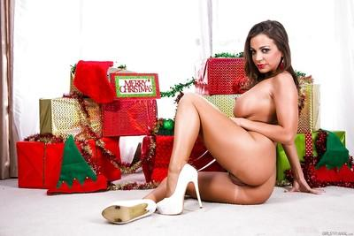 Christmas babe Abigail Mac is spreading her legs and masturbating