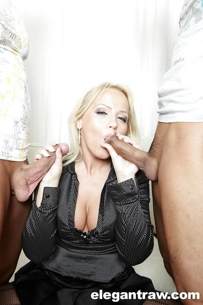 European pornstar Sarah Simon sucking off two cocks and swallowing cum