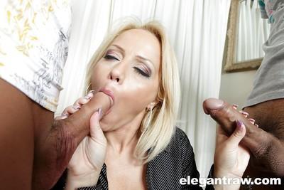 European pornstar Sarah Simon sucking off two cocks and swallowing cum