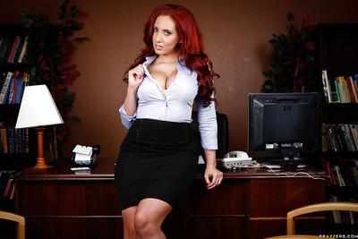 Curvaceous redhead MILF Kelly Divine stripping off her suit in the office