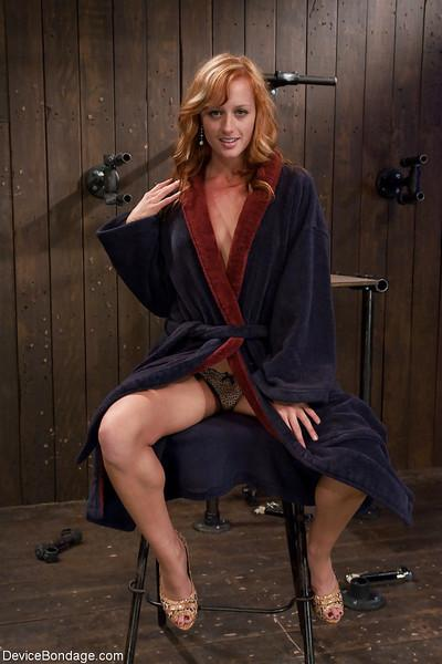 Redheaded MILF Ariel has hands restrained behind back before nipple torture