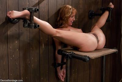 Redheaded MILF Ariel has hands restrained behind back before nipple torture