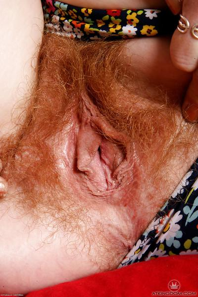 Barefoot redhead Ana Molly flashing furry underarms and vagina