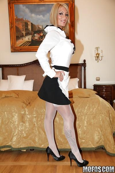 Sassy european MILF in maid uniform stripping and spreading her legs