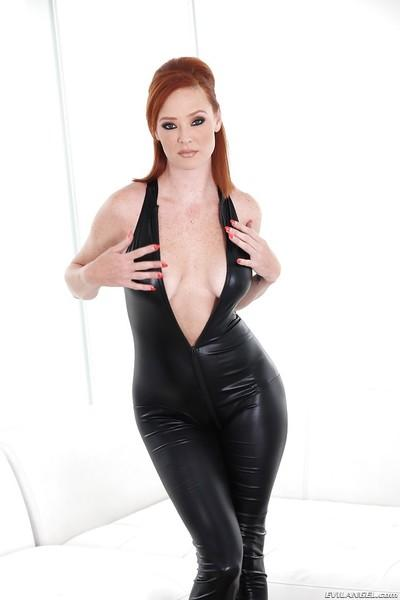 Horny redhead babe in latex Audrey undressing and posing
