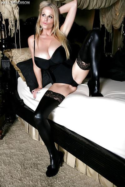 Chesty blonde mom Kelly Madison striking sexy poses in latex stockings