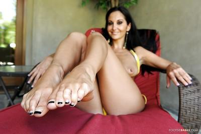 Milf with nice tattoos Ava Addams removes her yellow panties