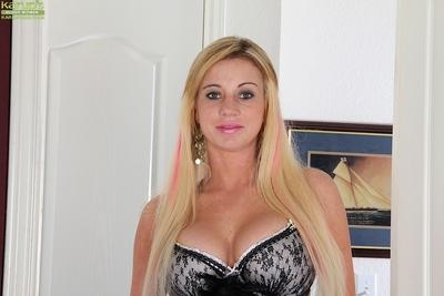 Blonde maid Crystal Forrester freeing huge knockers from maid uniform