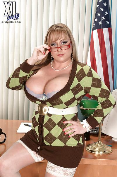 Buxom MILF in glasses Dixie Devereaux stripping in the office