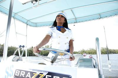Indian MILF in captain uniform Priya Anjeli Rai stripping on the yacht