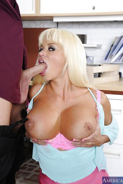 Blonde whore with big tits Nikita is giving a stunning blowjob