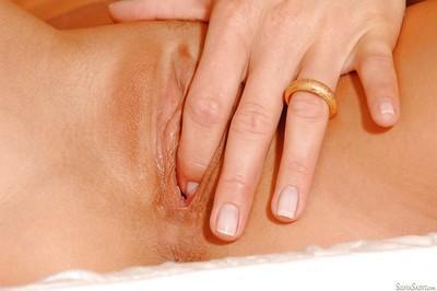 Sexy blonde Euro pornstar Silvia Saint exposing shaved MILF pussy close up