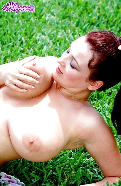 Redhead MILF babe model Lorna Morgan exposing big natural tits outdoors