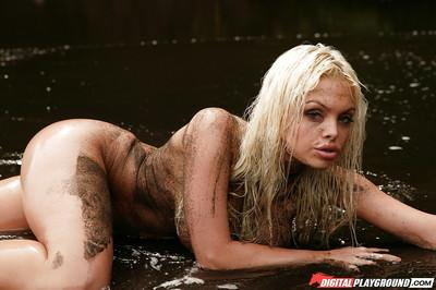 Dirty blonde Jesse Jane is posing on the beach with naked boobies