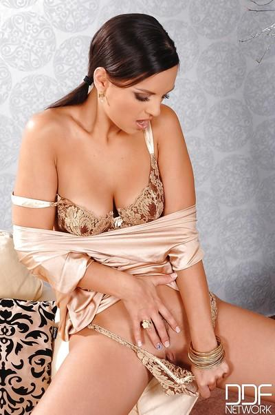 Beautiful Euro pornstar Eve Angel posing for fully clothed pics in dress