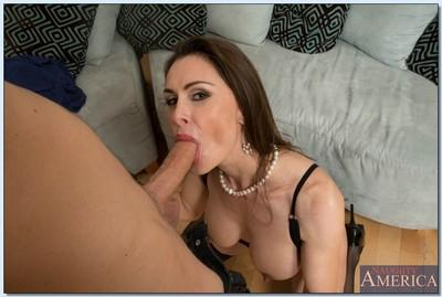 Hot MILF in stockings Nora Noir gets fucked hardcore by a younger guy